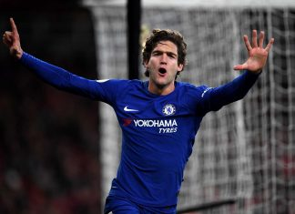 Marcos Alonso celebrates after scoring his sides second goal during the Premier League match between Arsenal and Chelsea at Emirates Stadium on January 3, 2018 in London.