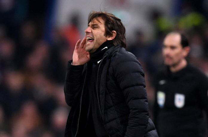 Antonio Conte reacts during the Carabao Cup Semi-Final First Leg match between Chelsea and Arsenal at Stamford Bridge on January 10, 2018 in London.