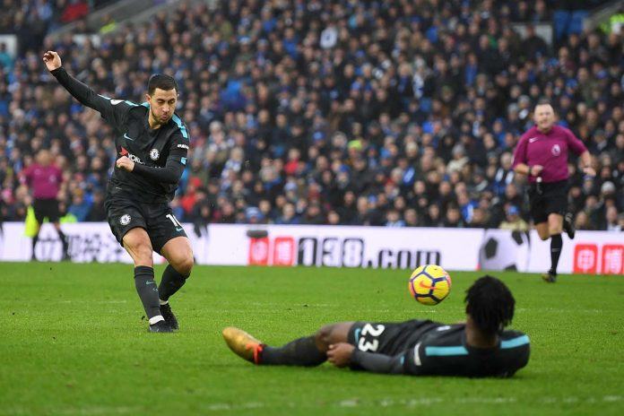 Eden Hazard scores the third goal during the Premier League match between Brighton and Hove Albion and Chelsea at Amex Stadium on January 20, 2018 in Brighton.