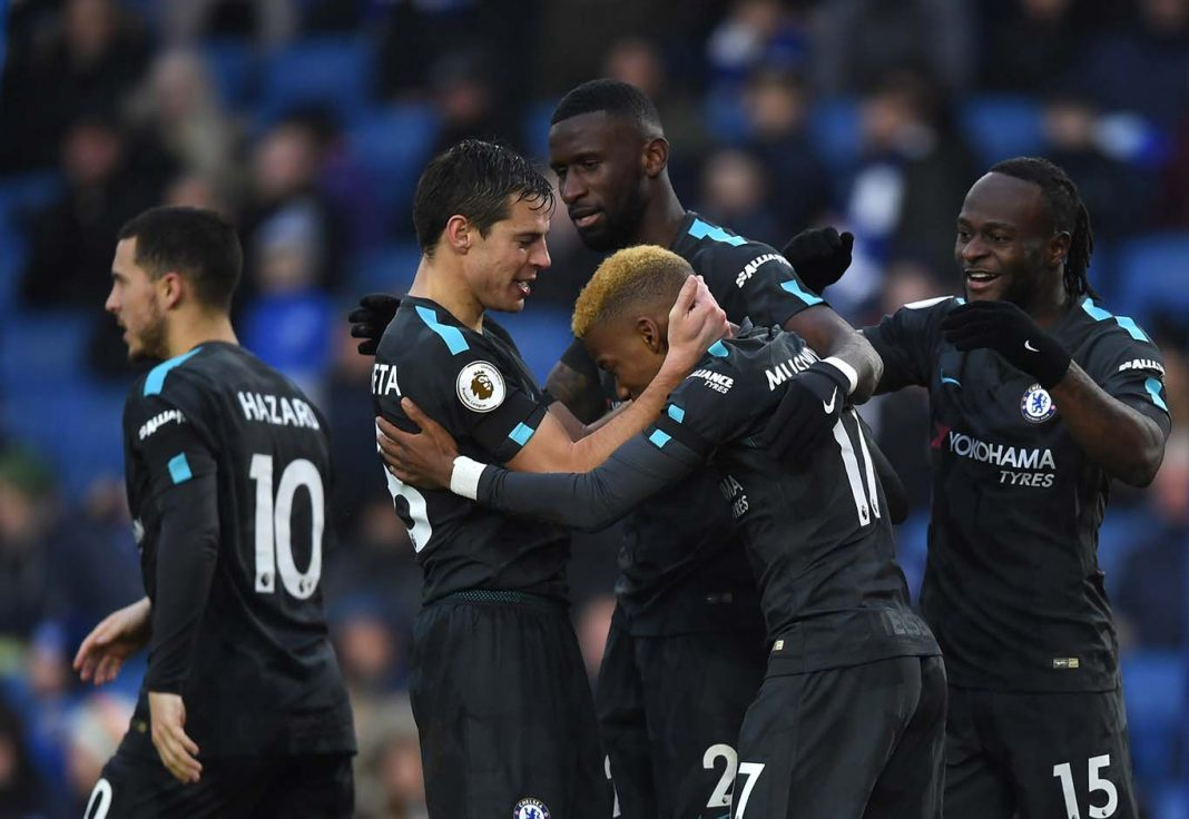 Victor Moses of celebrates scoring his side's fourth goal with team mates during the Premier League match between Brighton and Hove Albion and Chelsea at Amex Stadium on January 20, 2018 in Brighton.