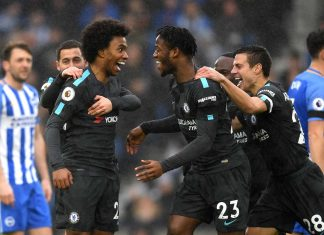 Willian celebrates as he scores the second goal with team mates during the Premier League match between Brighton and Hove Albion and Chelsea at Amex Stadium on January 20, 2018 in Brighton.