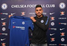 Emerson Palmieri holds his new shirt at Stamford Bridge on January 30, 2018.