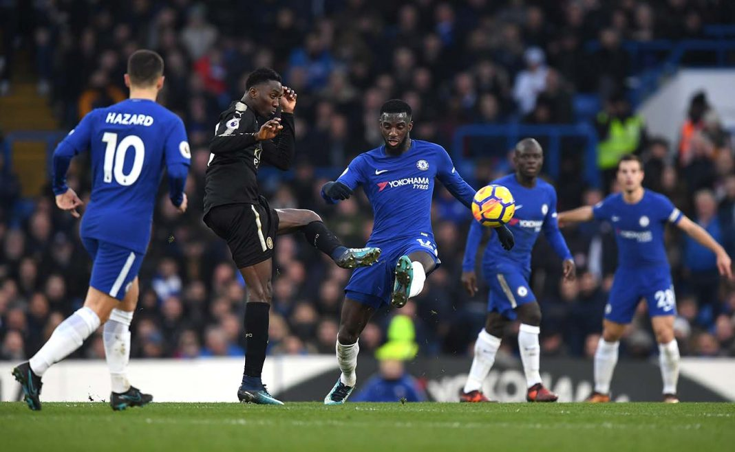 Wilfred Ndidi of Leicester City and Tiemoue Bakayoko battle for possession during the Premier League match between Chelsea and Leicester City at Stamford Bridge on January 13, 2018 in London.