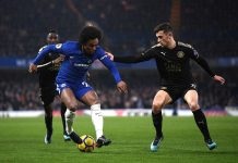 Willian is challenged by Ben Chilwell of Leicester City during the Premier League match between Chelsea and Leicester City at Stamford Bridge on January 13, 2018 in London.