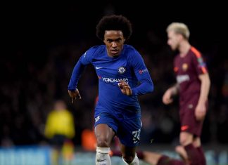 Willian celebrates after scoring his sides first goal during the UEFA Champions League Round of 16 First Leg match between Chelsea FC and FC Barcelona at Stamford Bridge on February 20, 2018 in London.