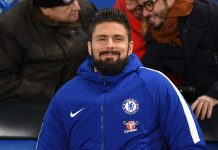 Olivier Giroud is seen in the stands prior to the Premier League match between Chelsea and AFC Bournemouth at Stamford Bridge on January 31, 2018 in London.