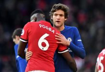 Paul Pogba of Manchester United and Marcos Alonso hug after the Premier League match between Manchester United and Chelsea at Old Trafford on February 25, 2018 in Manchester.