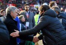 Jose Mourinho, Manager of Manchester United and Antonio Conte, shake hands during the Premier League match between Manchester United and Chelsea at Old Trafford on February 25, 2018 in Manchester.