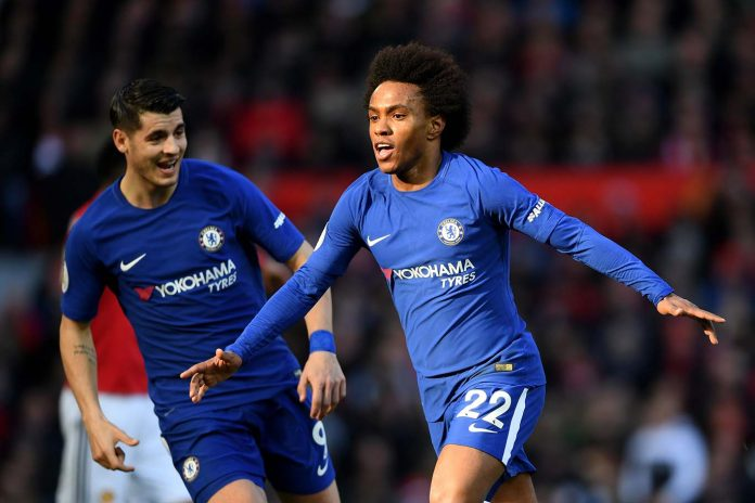 Willian celebrates after scoring his sides first goal during the Premier League match between Manchester United and Chelsea at Old Trafford on February 25, 2018 in Manchester.