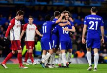 Eden Hazard celebrates after scoring his sides third goal with his team mates during the Premier League match between Chelsea and West Bromwich Albion at Stamford Bridge on February 12, 2018 in London.