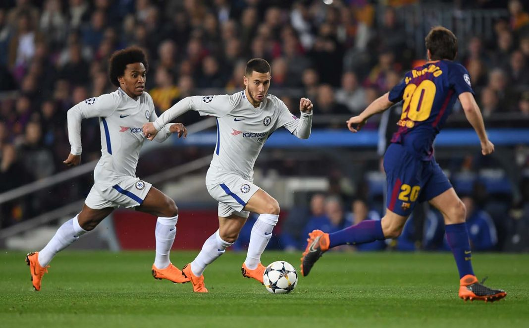 Eden Hazard and Willian run at Sergi Roberto of Barcelona during the UEFA Champions League Round of 16 Second Leg match FC Barcelona and Chelsea FC at Camp Nou on March 14, 2018 in Barcelona, Spain.