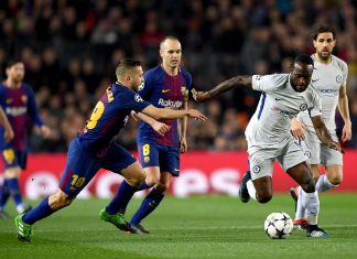 Victor Moses evades Jordi Alba of Barcelona during the UEFA Champions League Round of 16 Second Leg match FC Barcelona and Chelsea FC at Camp Nou on March 14, 2018 in Barcelona, Spain.