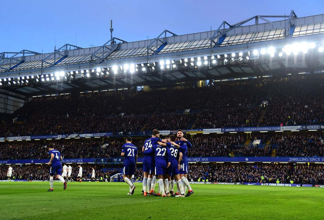 Willian celebrates with teammates after scoring his sides first goal during the Premier League match between Chelsea and Crystal Palace at Stamford Bridge on March 10, 2018 in London.