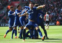 Gary Cahill celebrates teammate Olivier Giroud's second, and his sides third goal during the Premier League match between Southampton and Chelsea at St Mary's Stadium on April 14, 2018 in Southampton.