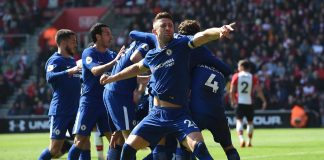 Gary Cahill celebrates with teammate Olivier Giroud's second, and his sides third goal during the Premier League match between Southampton and Chelsea at St Mary's Stadium on April 14, 2018 in Southampton.