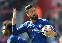 Olivier Giroud celebrates after scoring his sides first goal during the Premier League match between Southampton and Chelsea at St Mary's Stadium on April 14, 2018 in Southampton.