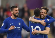 Cesc Fabregas celebrates with teammates Olivier Giroud and Eden Hazard after scoring his first goal during the Premier League match between Swansea City and Chelsea at Liberty Stadium on April 28, 2018 in Swansea, Wales.