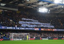 Banners are seen in remembrance of former football player and coach Ray Wilkins prior to the Premier League match between Chelsea and West Ham United at Stamford Bridge on April 8, 2018 in London.