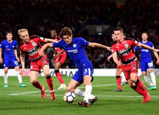 Marcos Alonso shoots while under pressure Alex Pritchard of Huddersfield Town during the Premier League match between Chelsea and Huddersfield Town at Stamford Bridge on May 9, 2018 in London, England. (Photo by Darren Walsh/Chelsea FC via Getty Images)