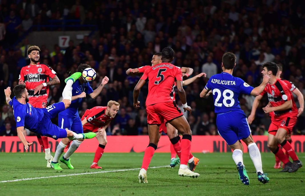 Olivier Giroud shoots during the Premier League match between Chelsea and Huddersfield Town at Stamford Bridge on May 9, 2018 in London.