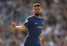 Olivier Giroud of celebrates after scoring his sides first goal during the Premier League match between Chelsea and Liverpool at Stamford Bridge on May 6, 2018 in London, England.