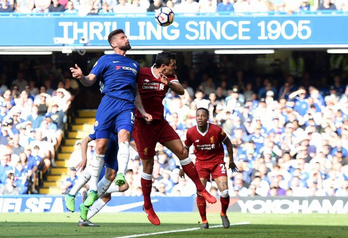 Olivier Giroud scores his sides first goal during the Premier League match between Chelsea and Liverpool at Stamford Bridge on May 6, 2018 in London, England.