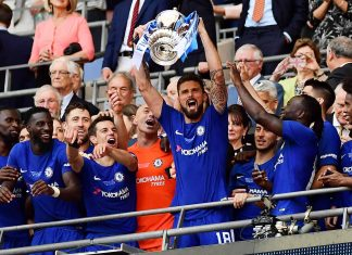 Olivier Giroud lifts the Emirates FA Cup trophy following his sides victory in The Emirates FA Cup Final between Chelsea and Manchester United at Wembley Stadium on May 19, 2018 in London.