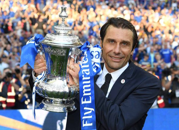 Antonio Conte, poses with the Emirates FA Cup trophy following his sides win in The Emirates FA Cup Final between Chelsea and Manchester United at Wembley Stadium on May 19, 2018 in London.