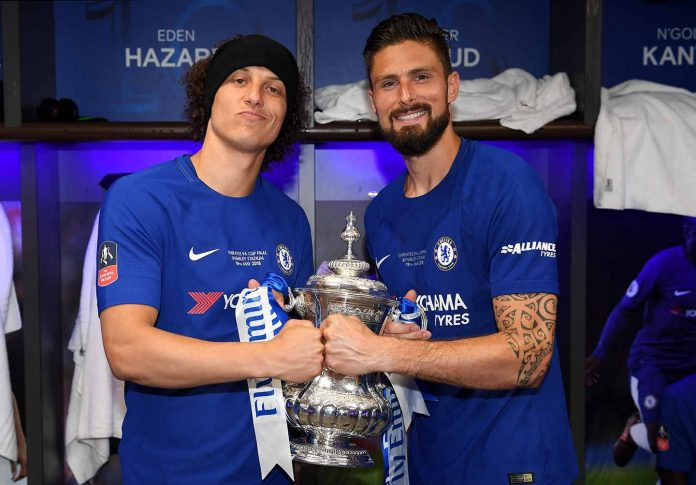 David Luiz and Olivier Giroud pose with the Emirates FA Cup trophy following their sides victory in The Emirates FA Cup Final between Chelsea and Manchester United at Wembley Stadium.