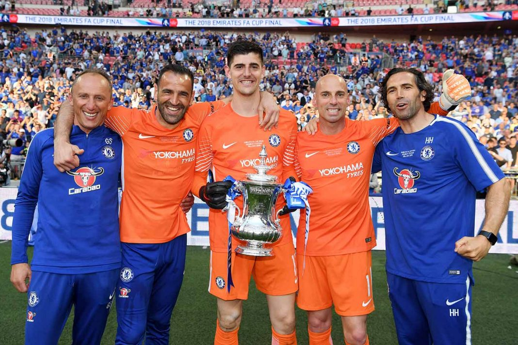 Goalkeeping coach Gianluca Spinelli, Eduardo of Chelsea, Thibaut Courtois of Chelsea, Willy Caballero of Chelsea, and Henrique Hilario, assistant goalkeeping coach pose with the Emirates FA Cup trophy following their sides victory in The Emirates FA Cup Final between Chelsea and Manchester United at Wembley Stadium on May 19, 2018 in London.