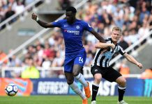 Tiemoue Bakayoko of Chelsea battles for possession with Matt Ritchie of Newcastle United during the Premier League match between Newcastle United and Chelsea at St. James Park on May 13, 2018 in Newcastle upon Tyne.