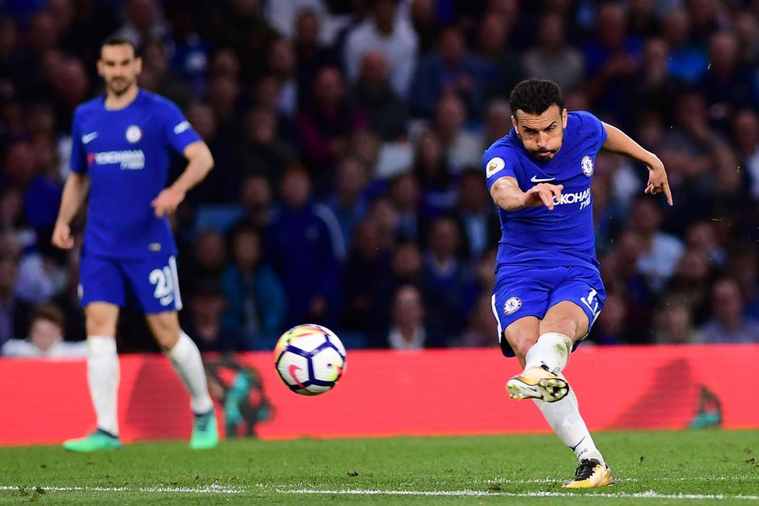 Pedro shoots during the Premier League match between Chelsea and Huddersfield Town at Stamford Bridge on May 9, 2018 in London.