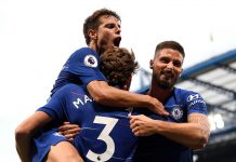Marcos Alonso celebrates after scoring his team's third goal with team mates Cesar Azpilicueta and Olivier Giroud during the Premier League match between Chelsea FC and Arsenal FC at Stamford Bridge on August 18, 2018 in London.