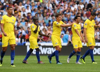 Pedro celebrates with teammates after scoring his team's third goal during the Premier League match between Huddersfield Town and Chelsea FC at John Smith's Stadium on August 11, 2018 in Huddersfield.