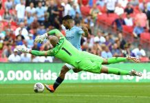 Willy Caballero makes a save from Sergio Aguero of Manchester City during the FA Community Shield between Manchester City and Chelsea at Wembley Stadium on August 5, 2018 in London. Getty Images)