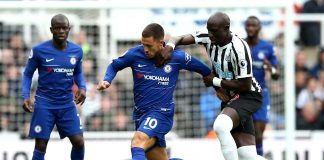 Eden Hazard is challenged by Mohamed Diame of Newcastle United during the Premier League match between Newcastle United and Chelsea FC at St. James Park on August 26, 2018 in Newcastle upon Tyne.