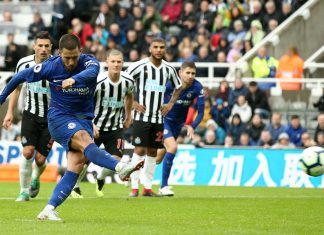 Eden Hazard scores a penalty for the first goal during the Premier League match between Newcastle United and Chelsea FC at St. James Park on August 26, 2018 in Newcastle upon Tyne.