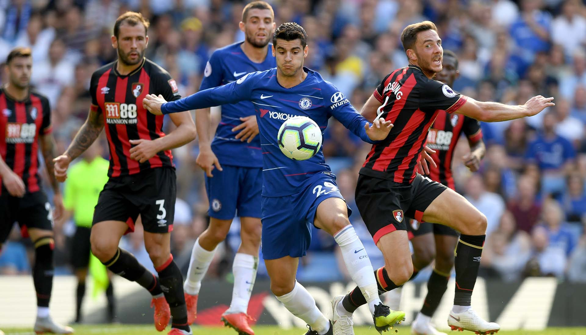 Alvaro Morata holds off Steve Cook and Dan Gosling of AFC Bournemouth during the Premier League match between Chelsea FC and AFC Bournemouth at Stamford Bridge on September 1, 2018 in London.