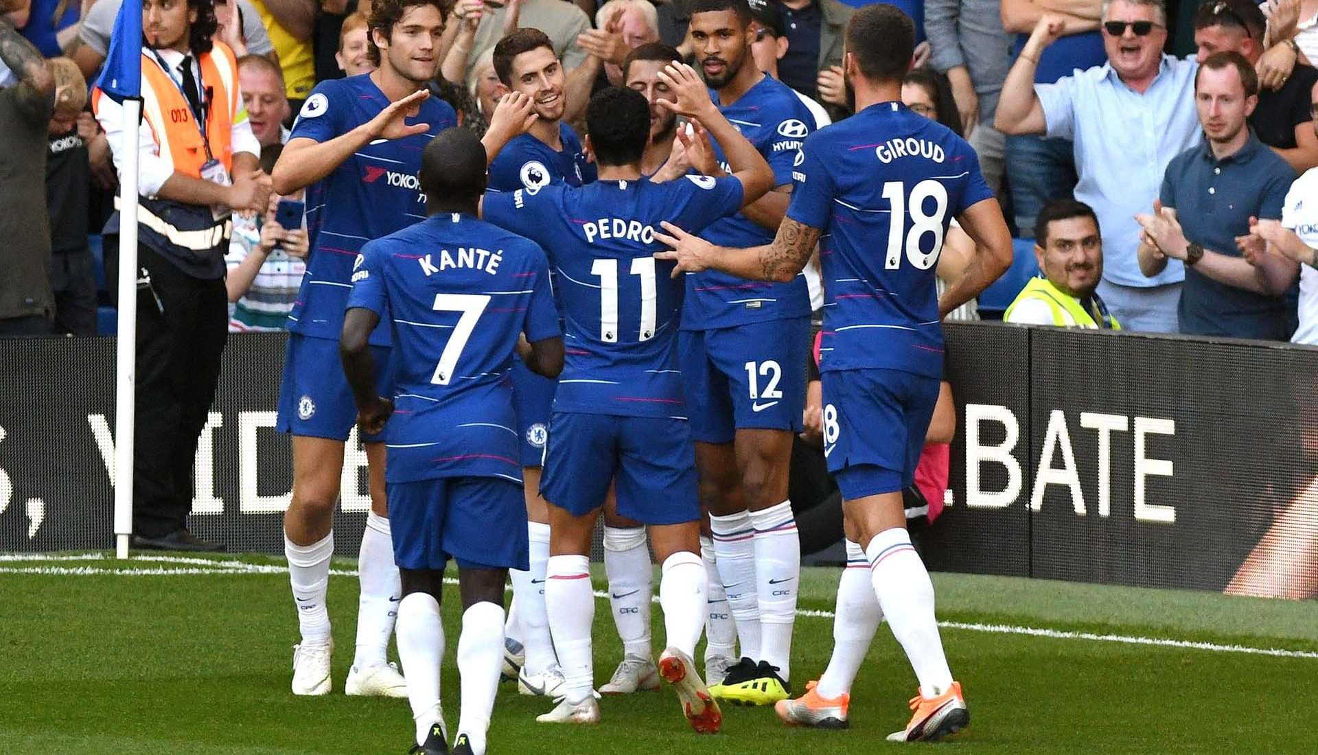 Eden Hazard celebrates with teammates after scoring his team's second goal during the Premier League match between Chelsea FC and AFC Bournemouth at Stamford Bridge on September 1, 2018 in London.