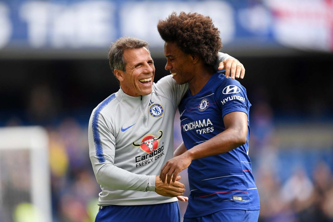 Willian celebrates with Gianfranco Zola, Assistant Coach of Chelsea during the Premier League match between Chelsea FC and Cardiff City at Stamford Bridge on September 15, 2018 in London, United Kingdom.