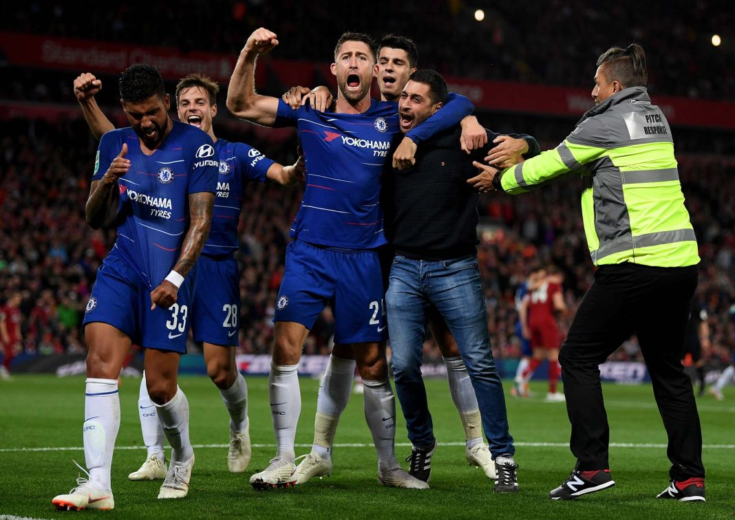 Emerson (left) celebrates with his teammates and a fan after he scores his sides first goal during the Carabao Cup Third Round match between Liverpool and Chelsea at Anfield on September 26, 2018 in Liverpool, England.