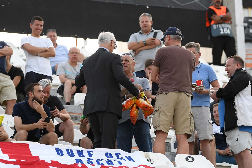 Bruce Buck, Chelsea chairman is seen handing out bags of crisps to Chelsea fans in the away stand prior to the UEFA Europa League Group L match between PAOK and Chelsea at Toumba Stadium on September 20, 2018 in Thessaloniki, Greece.