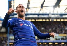 Eden Hazard celebrates scoring the opening goal during the Premier League match between Chelsea FC and Liverpool FC at Stamford Bridge on September 29, 2018 in London.