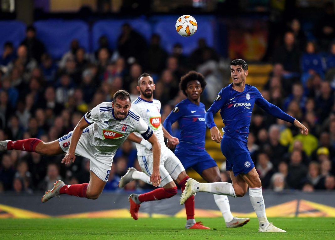 Roland Juhasz of MOL Vidi FC heads the ball under pressure from Alvaro Morata during the UEFA Europa League Group L match between Chelsea and Vidi FC at Stamford Bridge on October 4, 2018 in London.