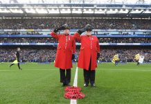 Chelsea Pensioners lay a Remembrance Day wreath prior during the Premier League match between Chelsea FC and Everton FC at Stamford Bridge on November 11, 2018 in London.