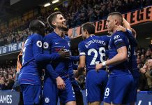 Alvaro Morata celebrates with teammates after scoring his team's first goal during the Premier League match between Chelsea FC and Crystal Palace at Stamford Bridge on November 4, 2018 in London, United Kingdom.