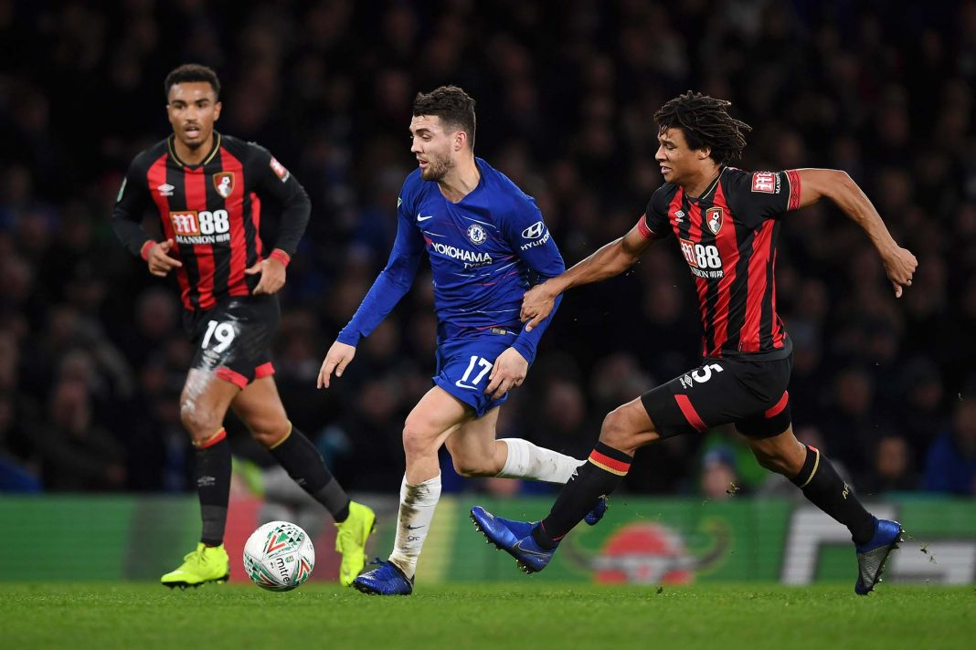Mateo Kovacic is challenged by Nathan Ake of AFC Bournemouth during the Carabao Cup Quarter Final match between Chelsea and AFC Bournemouth at Stamford Bridge on December 19, 2018 in London.