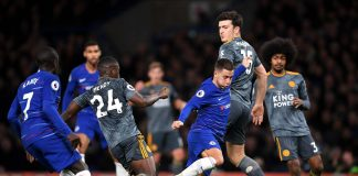 Eden Hazard of Chelsea is challenged by Nampalys Mendy of Leicester City and Ricardo Pereira of Leicester City during the Premier League match between Chelsea FC and Leicester City at Stamford Bridge on December 22, 2018 in London.