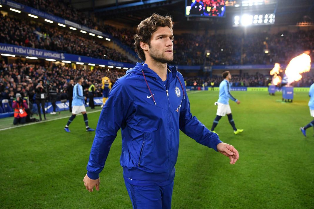 Marcos Alonso walks out prior to the Premier League match between Chelsea FC and Manchester City at Stamford Bridge on December 8, 2018 in London.