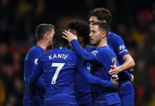 Eden Hazard celebrates with team mates after scoring their team's second goal from the penalty spot during the Premier League match between Watford FC and Chelsea FC at Vicarage Road on December 26, 2018 in Watford, United Kingdom.